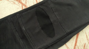 Black jeans with patch.